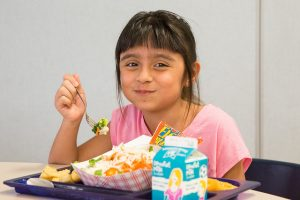 Isabella Perez chose a salad for lunch. Nearly 25,000 meals are served daily in Des Moines schools.