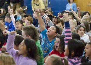 Children raising their hands.