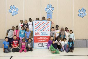 Students pose with award banner