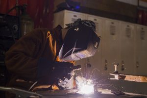 Student doing a welding project