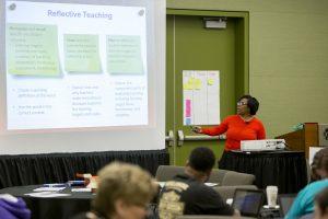 Speaker presenting to a room full of teachers