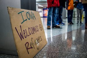Sign that reads Iowa welcomes refugees