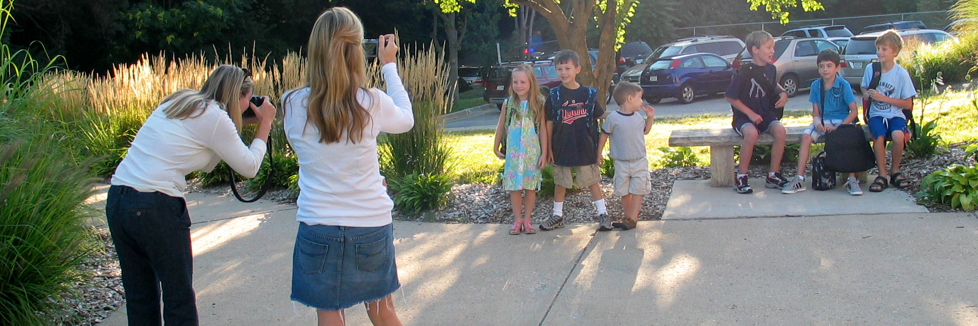 Parent taking back to school pictures of students.