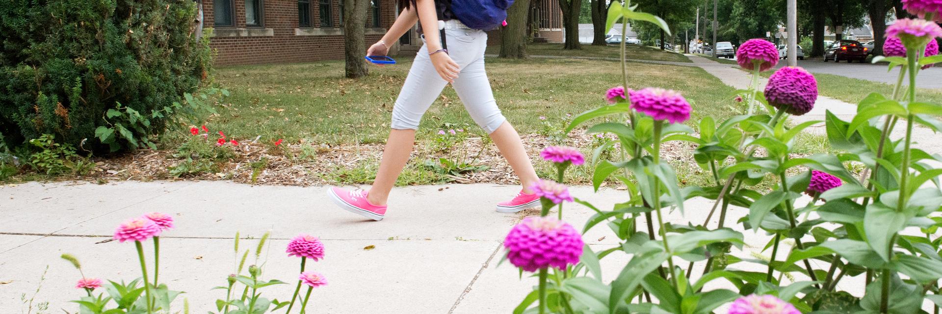 Unidentified student walks up school walkway.